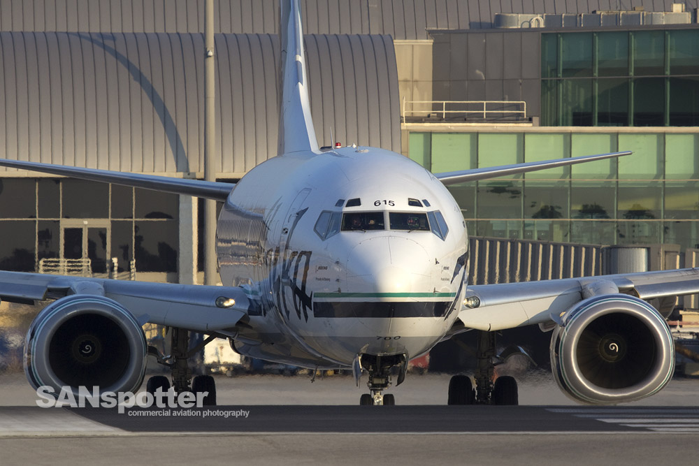 Close up nose shot of an Alaska Airlines 737 taxiing to departure at SNA