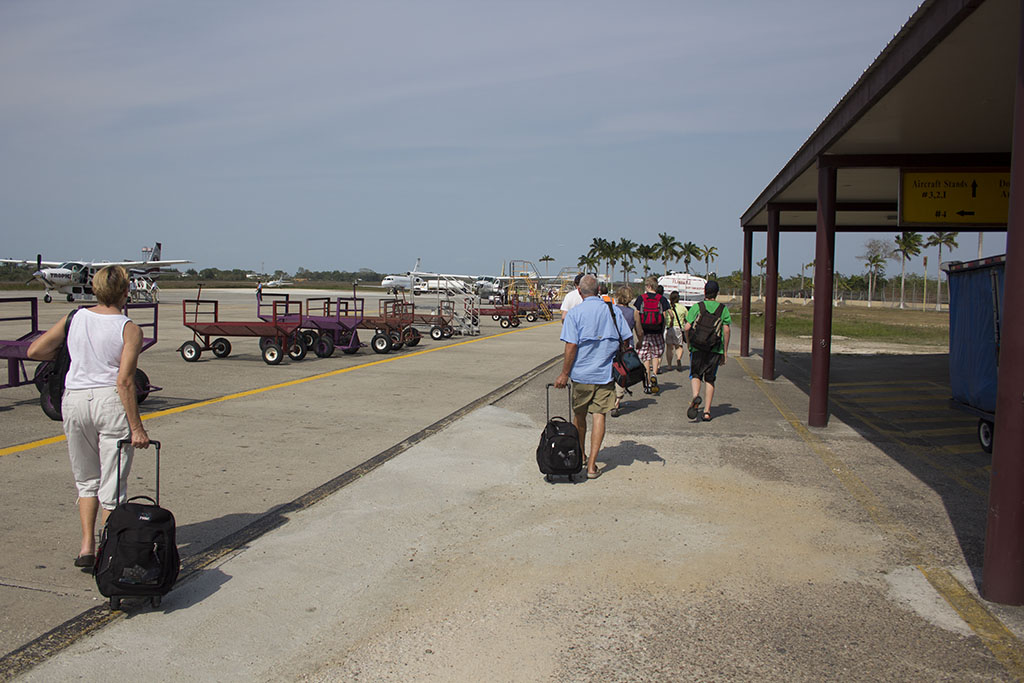 Walking out to our plane to Dangriga (DGA) at Belize City Airport (BZE)