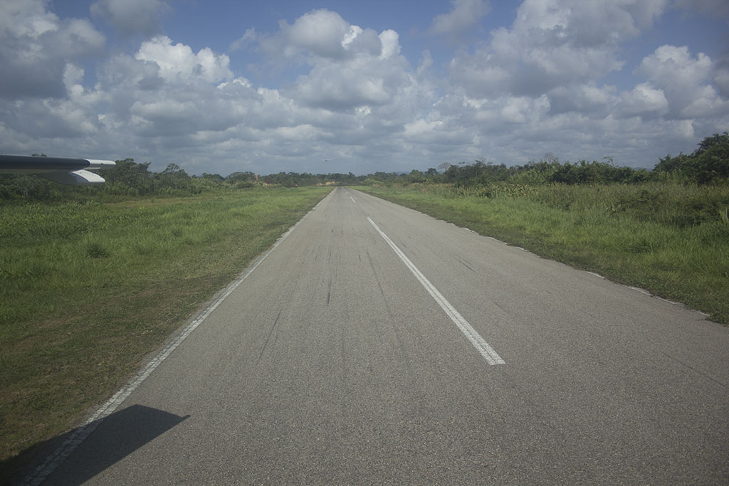 View looking straight down Dangriga's single runway. There are no taxiways here!