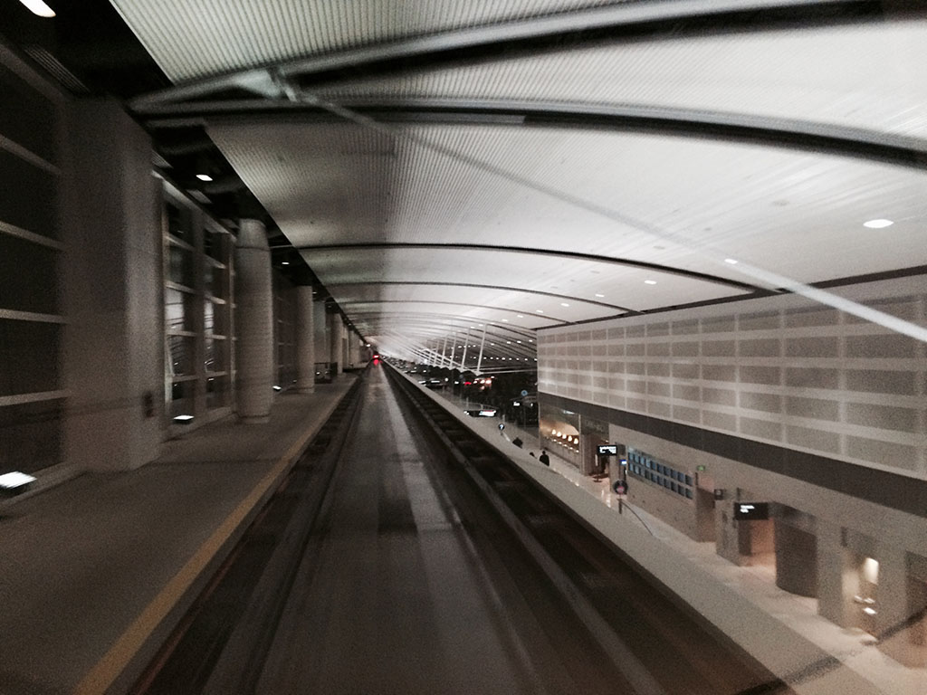 view from the back window of the elevated train at DTW