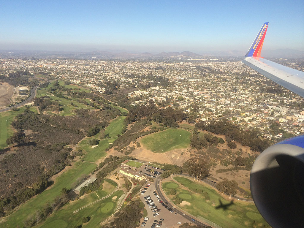 green hills of san diego on approach to SAN