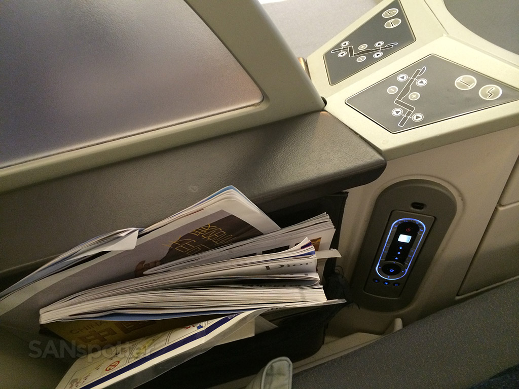 inconvenient place for magazines and in flight safety cards