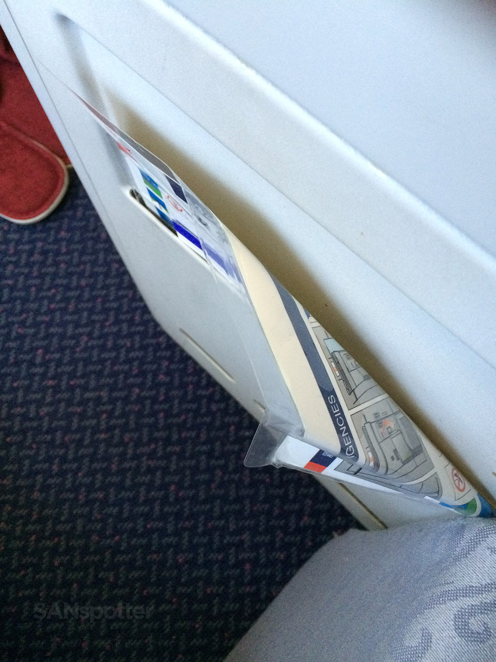 crumpled in-flight safety cards air china business class