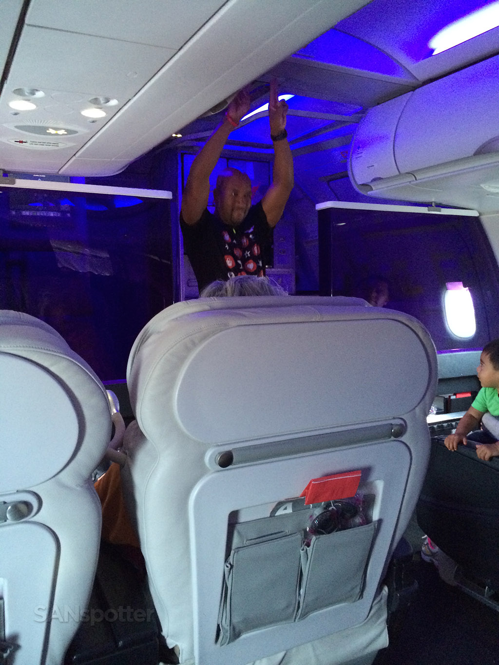 flight attendant performing the dance-based safety routine