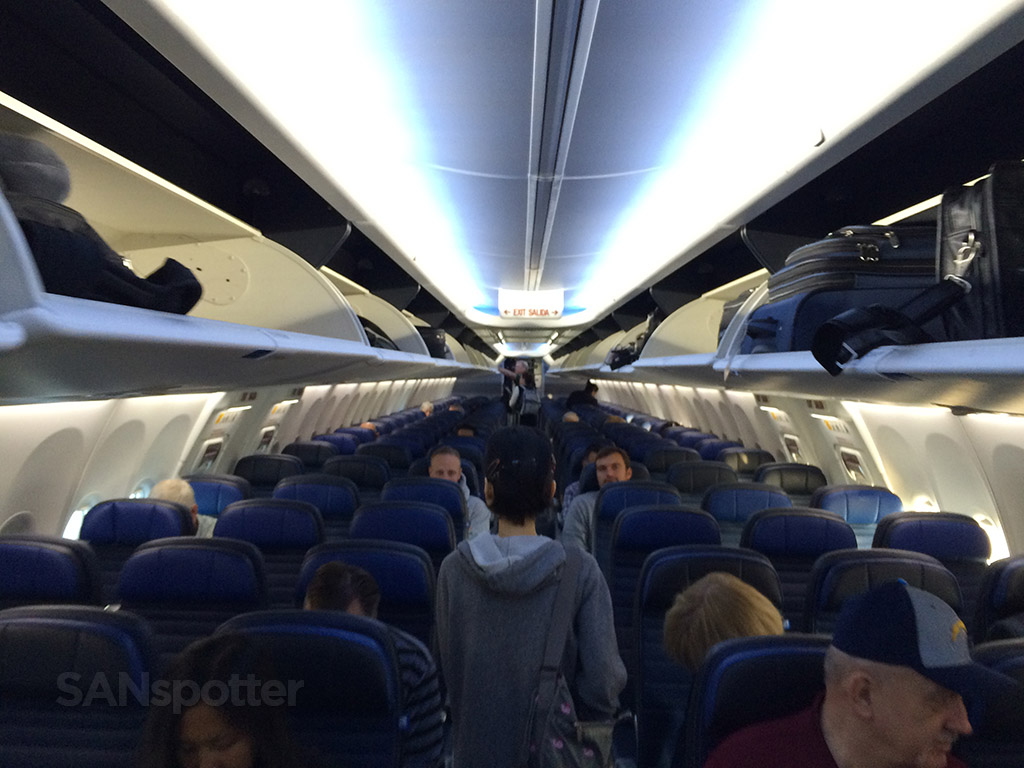 walking down the long aisle of the united airlines 737-900