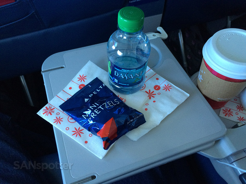 water and pretzel snack in first class
