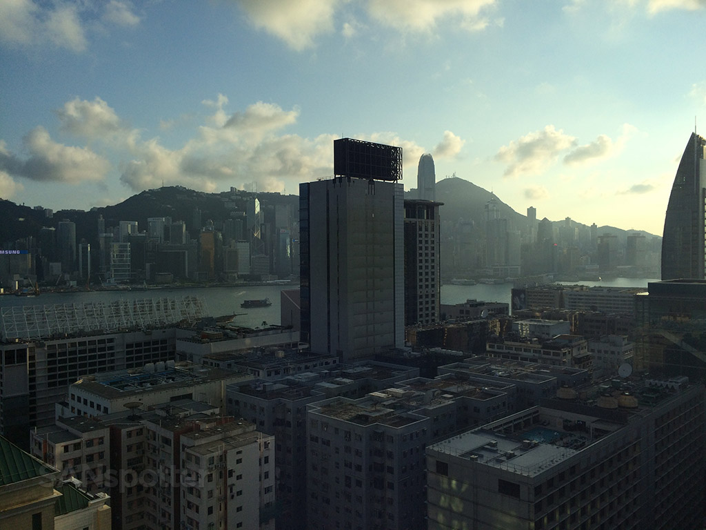 sun setting over hong kong