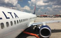 delta airlines 737-900 parked at gate
