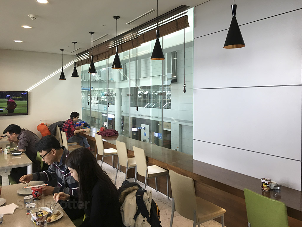 korean air prestige class lounge communal seating