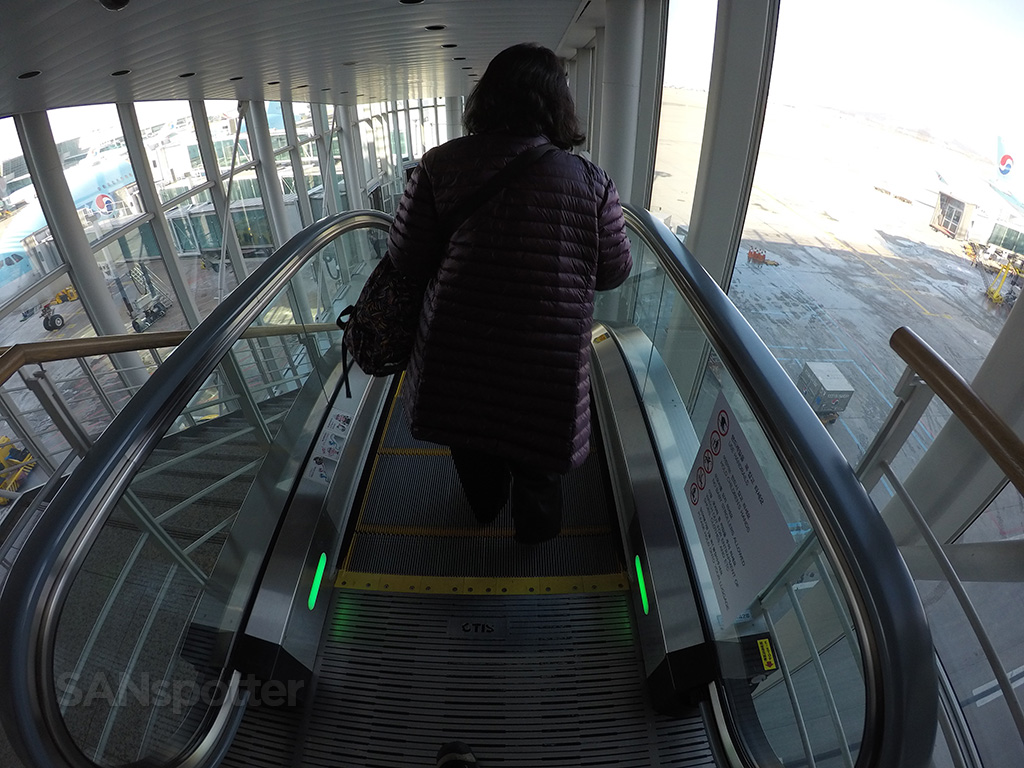 Down the escalator we go