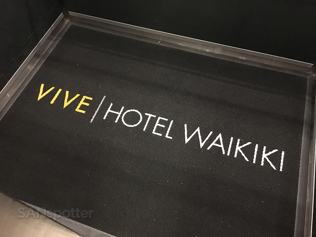 Vive hotel welcome mat