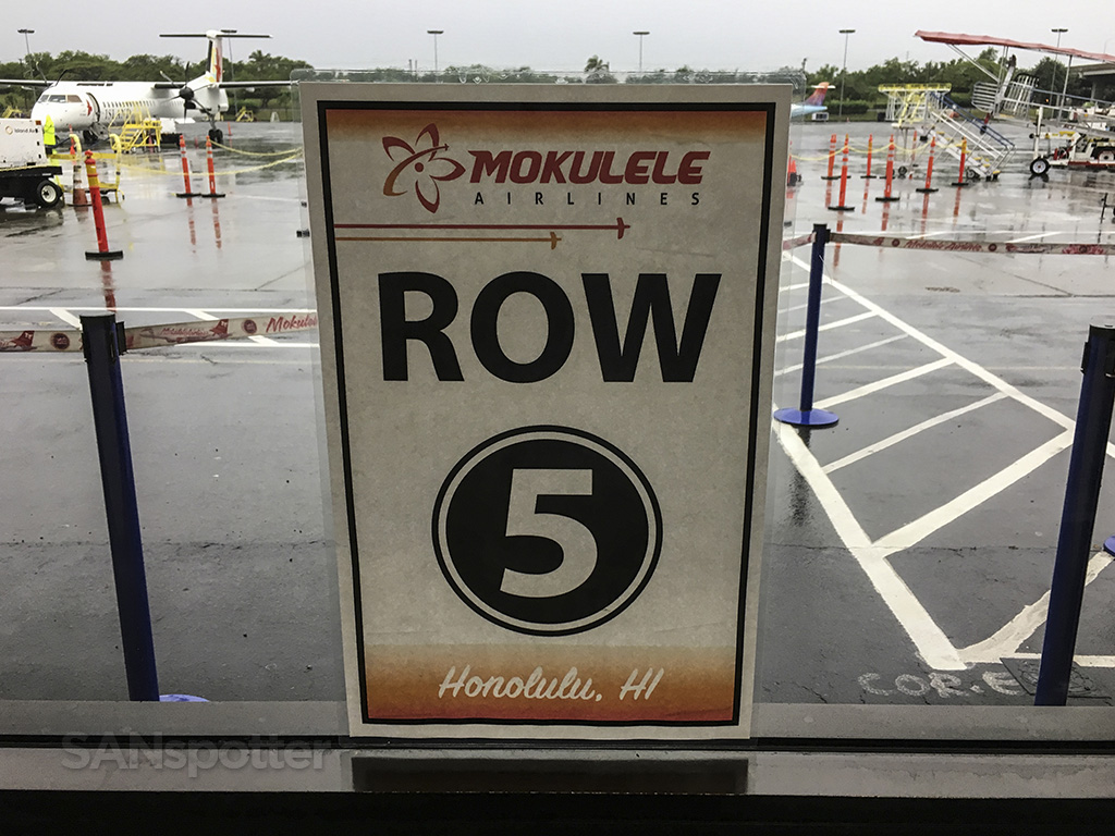 Mokulele Airlines row 5 sign