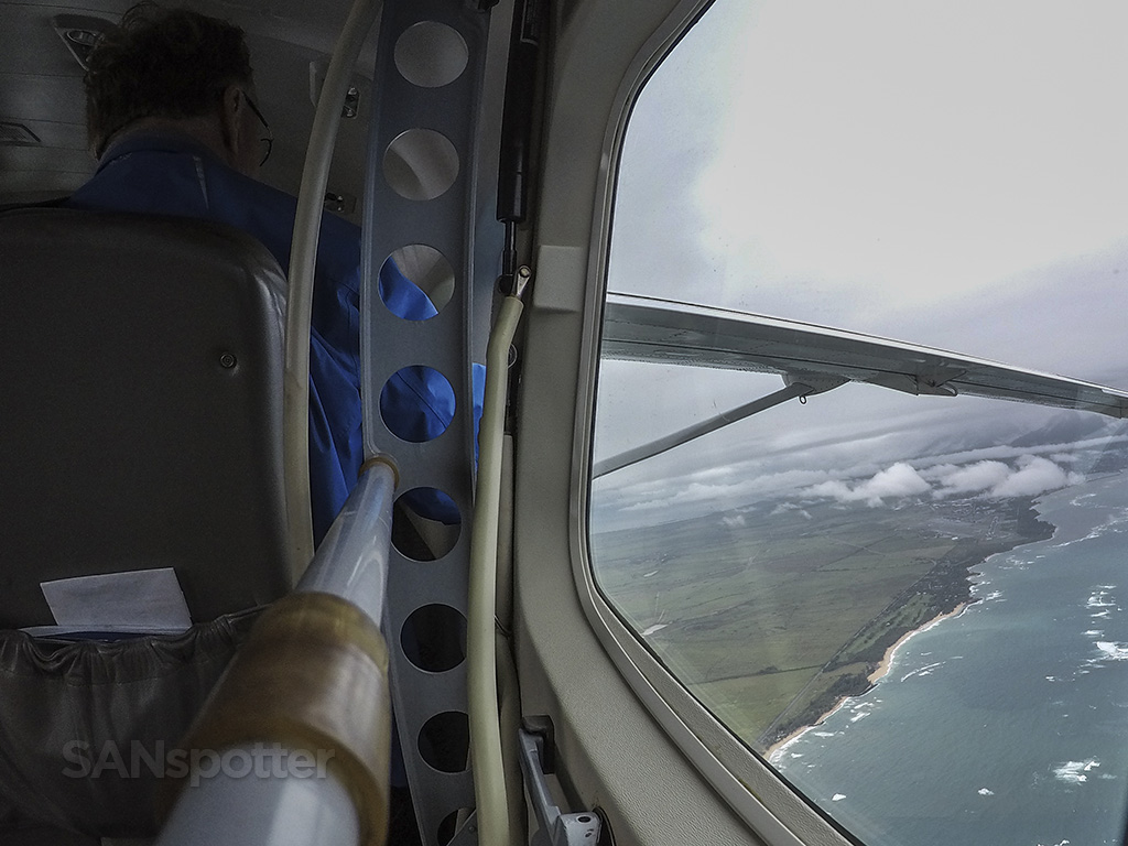 cessna 208 interior flying over maui