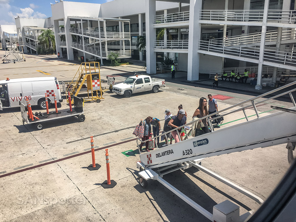 Boarding airplane via air stairs Cancun airport