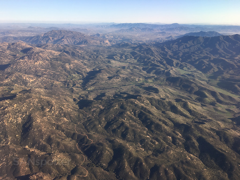 Approach into San Diego airport over mountains
