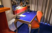 Radisson Blu ZRH hotel room blue carpet red furniture