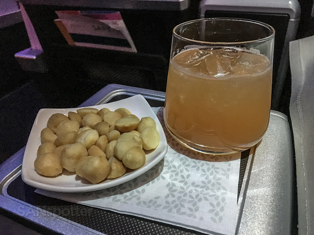 Hawaiian Airlines first class guava juice and a macadamia nuts
