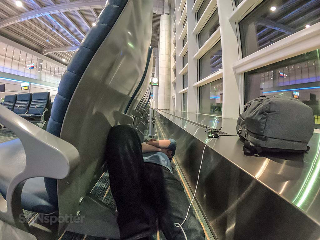 sanspotter selfie sleeping in airport