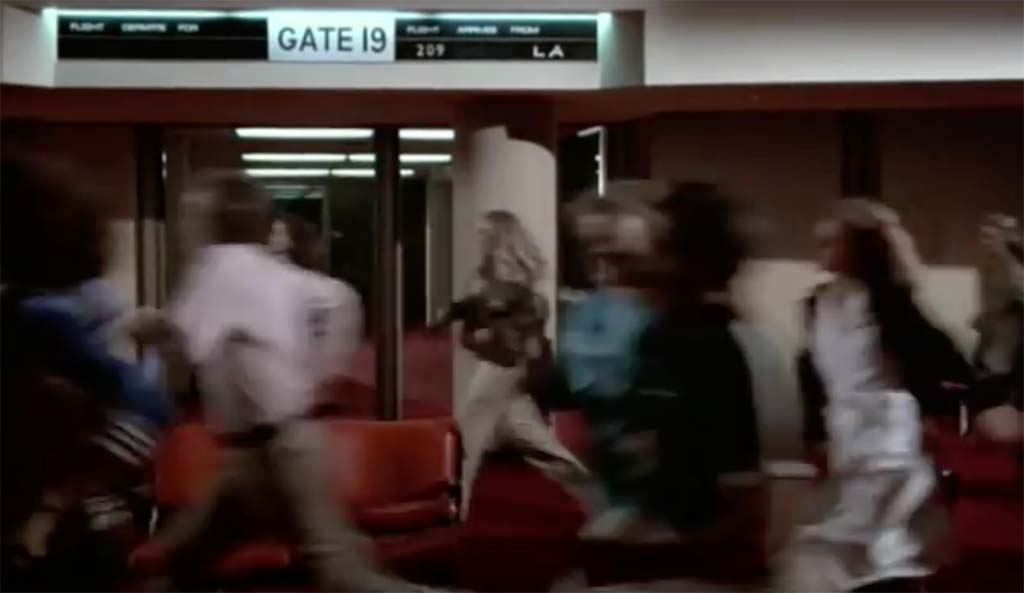 Airplane now arriving at gate 8 movie quote