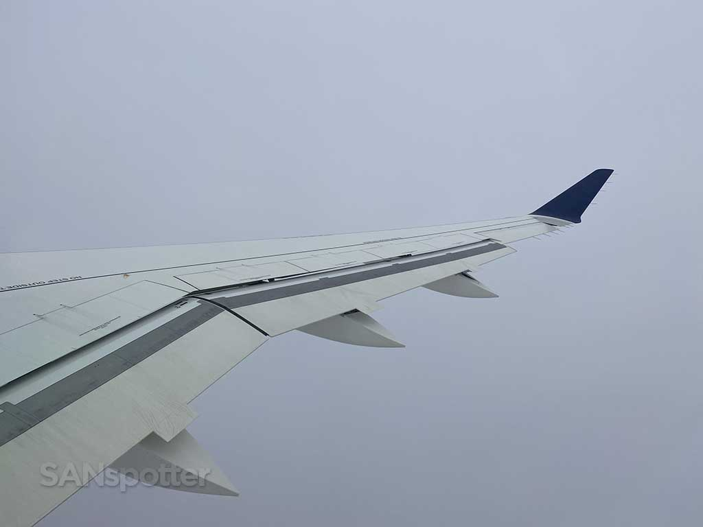 Descent into clouds a220 wing