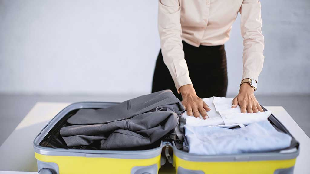 packing a suit in a suitcase