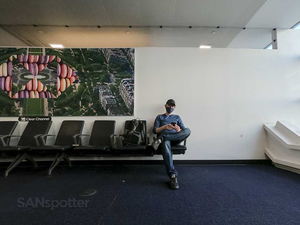 SANspotter sitting in chair at jfk airport