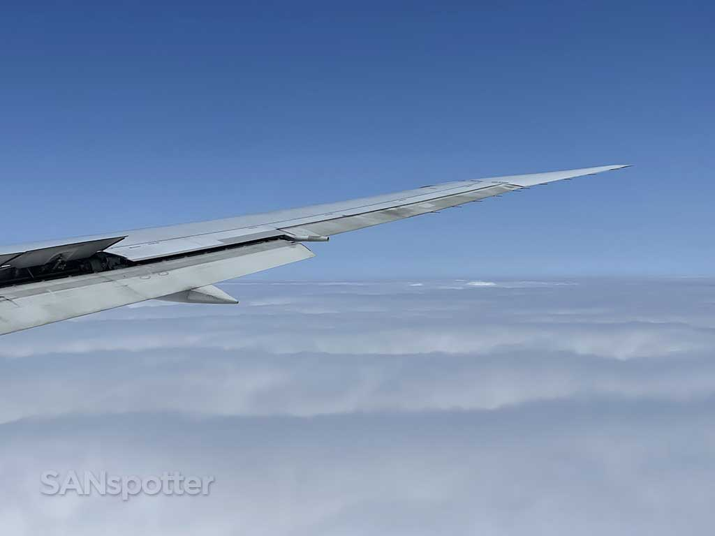 767-400 wing and clouds