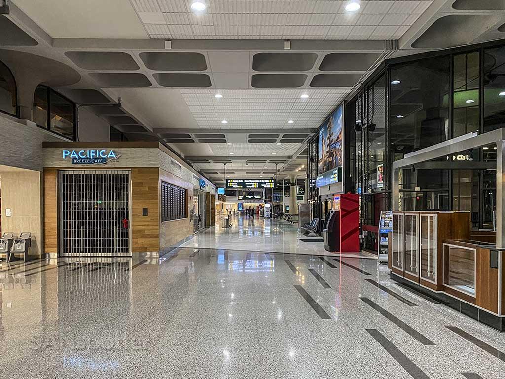 walking through airport terminal